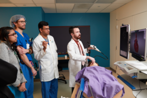 Dr. Lak teaching residents in the anesthesiology simulation center.