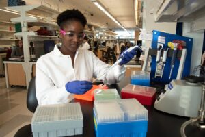 summer research fellowship student working in lab